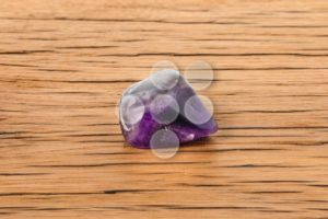 Amethyst on oak surface - Popular Stock Photos