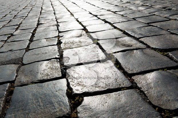 Angled pattern historic cobbled street - Popular Stock Photos