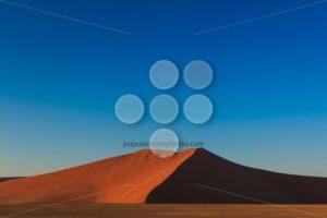Big red sand dune sunrise magic Sossusvlei - Popular Stock Photos