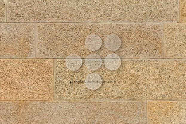 Big yellow stone wall close up - Popular Stock Photos