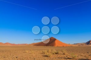 Blue sky above red sand dune landscape Sossusvlei - Popular Stock Photos