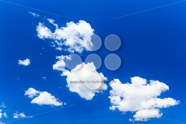 Blue sky with several clouds - Popular Stock Photos