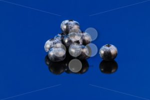 Blueberry on blue surface - Popular Stock Photos
