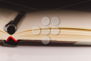 Book close up pencil partial light - Popular Stock Photos
