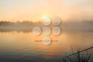 Carp fishing misty lake France - Popular Stock Photos