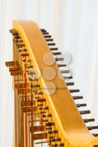 Celtic harp close-up string adjustment - Popular Stock Photos