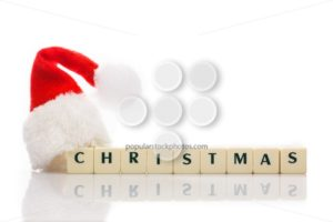 Christmas spelled text dice cubes hat santa - Popular Stock Photos
