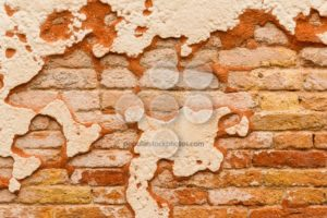 Close up brick wall broken plaster - Popular Stock Photos