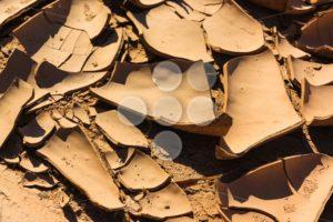 Close up cracks dry riverbed - Popular Stock Photos
