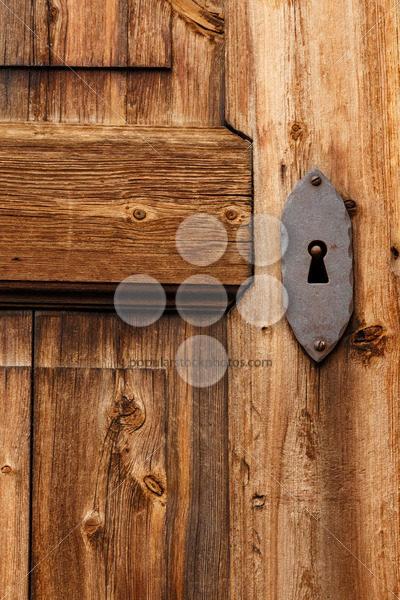 Close-up old wooden door keyhole - Popular Stock Photos