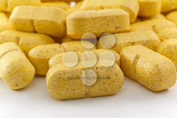Close up several yellow pills – Popular Stock Photos