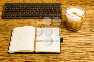 Concept empty notebook pencil keyboard start day - Popular Stock Photos
