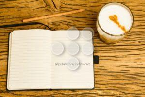 Concept empty notebook pencil start day - Popular Stock Photos