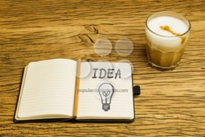Concept idea lightbulb notebook plan coffee - Popular Stock Photos