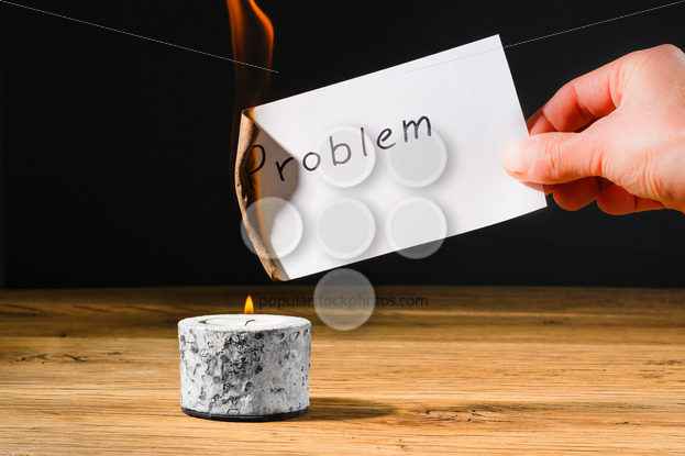 Concept solution probem by burning text on paper - Popular Stock Photos