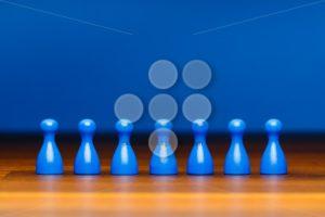 Concept team, business, organization, blue on wood - Popular Stock Photos