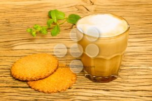 Cookie and cappuccino kitchen table oak - Popular Stock Photos