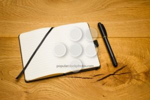 Empty pages notebook marker skew on desk - Popular Stock Photos