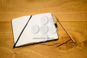 Empty pages notebook skew on desk - Popular Stock Photos