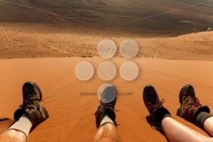 Enjoying resting climbing sand dune - Popular Stock Photos