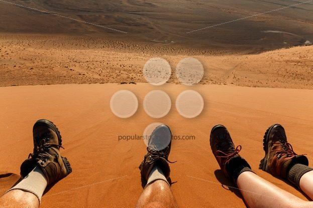 Enjoying resting climbing sand dune – Popular Stock Photos