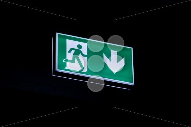 Exit sign hanging on ceiling in dark – Popular Stock Photos