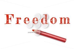 Freedom written red pencil - Popular Stock Photos