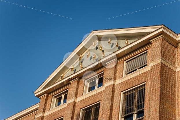 GRONINGEN, NETHERLANDS -NOVEMBER 01, 2014: Harmoniegebouw golden owls ode to Pallas Athena - Popular Stock Photos