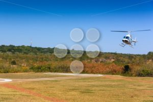 Helicopter landing on helipad - Popular Stock Photos