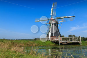Historic windmill in landscape The Netherlands - Popular Stock Photos