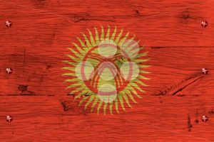 Kyrgyzstan national flag painted old oak wood fastened - Popular Stock Photos