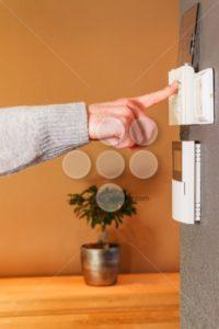 Man pushing button home appliance - Popular Stock Photos