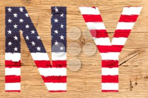 NY painted with pattern of flag United States old oak wood - Popular Stock Photos