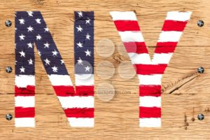 NY painted with pattern of flag United States old oak wood fastened - Popular Stock Photos