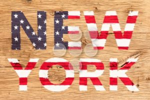 New York painted with pattern of flag United States old oak wood - Popular Stock Photos