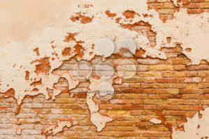 Old brick wall broken plaster - Popular Stock Photos