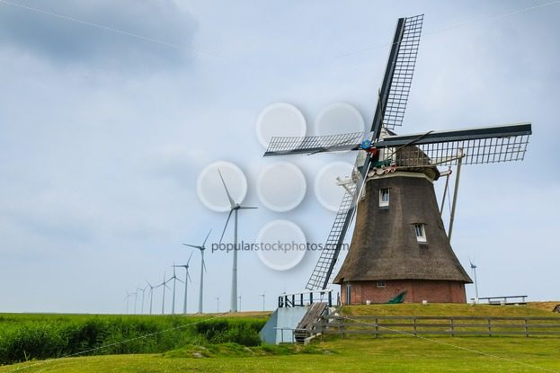 Old windmill and new wind turbines – Popular Stock Photos