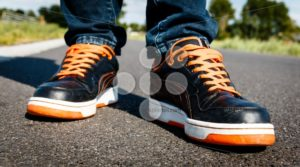 Orange black sport shoes, on the move - Popular Stock Photos