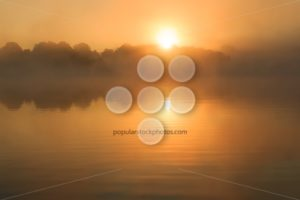Orange sun rising over lake France - Popular Stock Photos