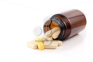 Pills brown bottle one different yellow - Popular Stock Photos