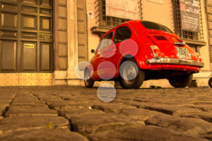 ROME, ITALY – MAY 10, 2016: Old red Fiat 500 on streets of Rome - Popular Stock Photos