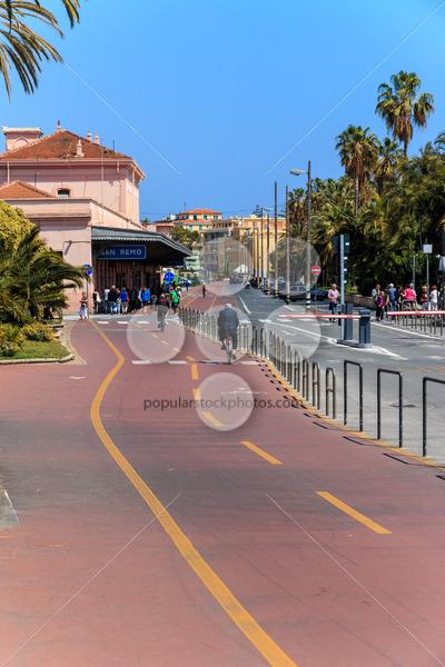 SAN REMO, ITALY – APRIL 29, 2016: People riding cicycle path nea - Popular Stock Photos