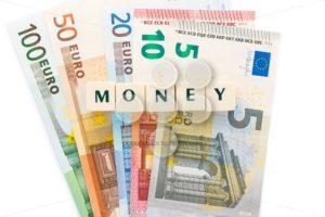 Several euro banknotes money text dice - Popular Stock Photos