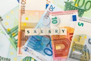 Several euro banknotes salary text dice - Popular Stock Photos