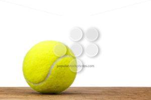 Single tennis ball table wood isolated - Popular Stock Photos