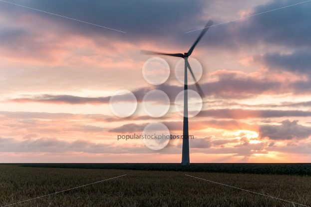Single windmill in motion at sunset – Popular Stock Photos