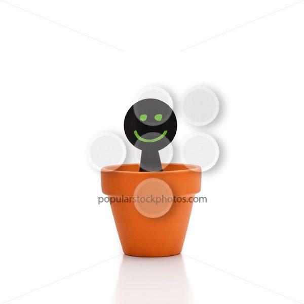 Smiling green black puppet flower pot - Popular Stock Photos