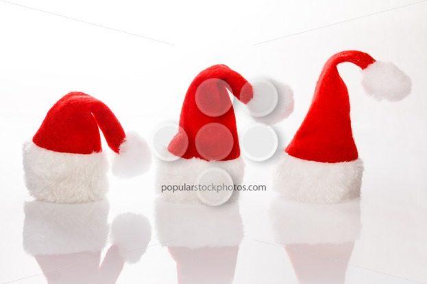 Three Christmas hats Santa row – Popular Stock Photos