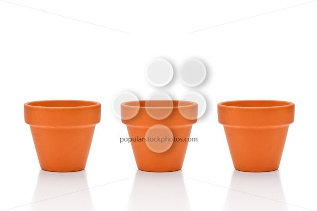 Three terracotta flower pots isolated on white - Popular Stock Photos