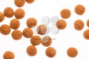 Throwing pepernoten isolated - Popular Stock Photos